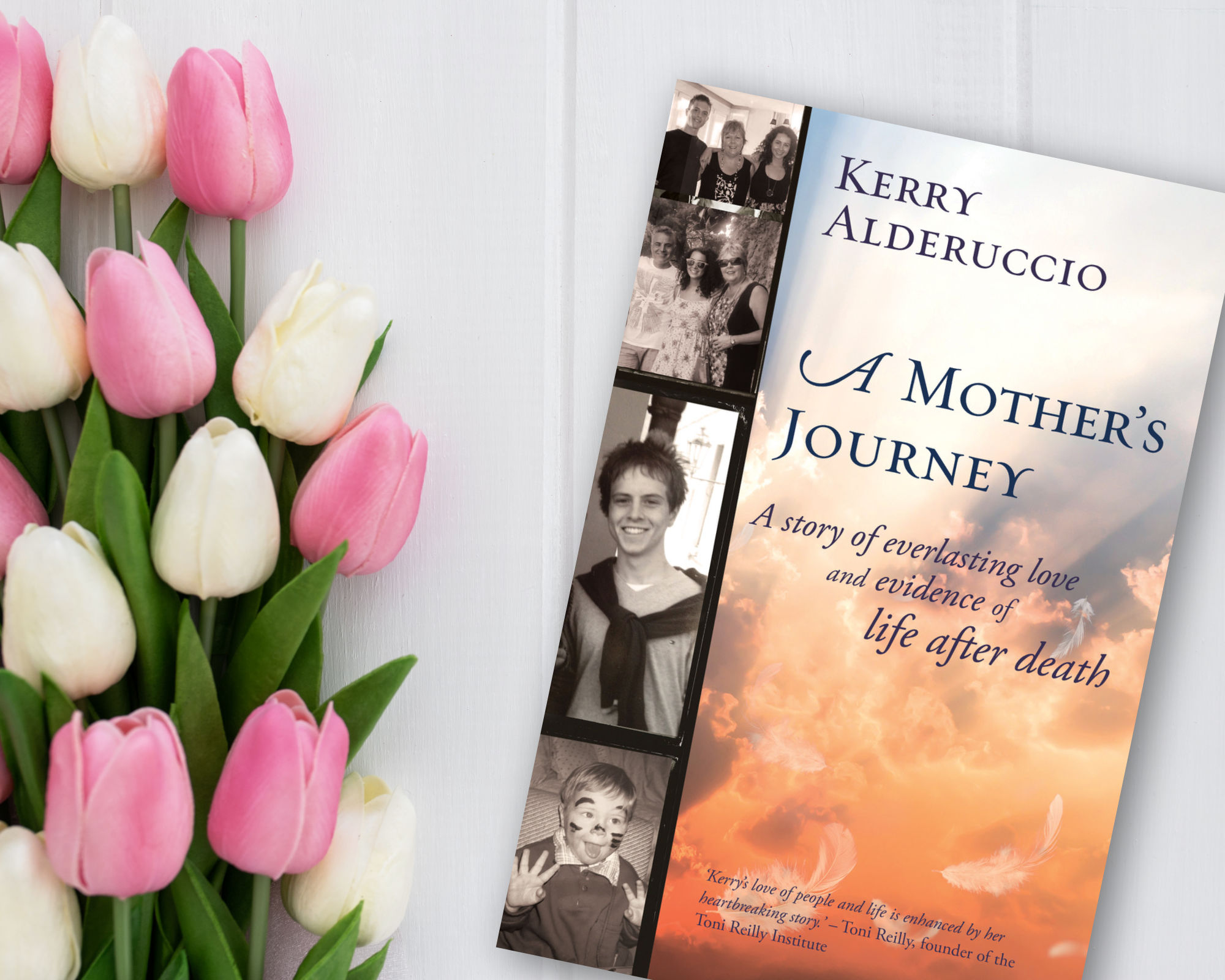 Kerry Alderuccio's book - A Mother's Journey photographed next to some beautiful flowers
