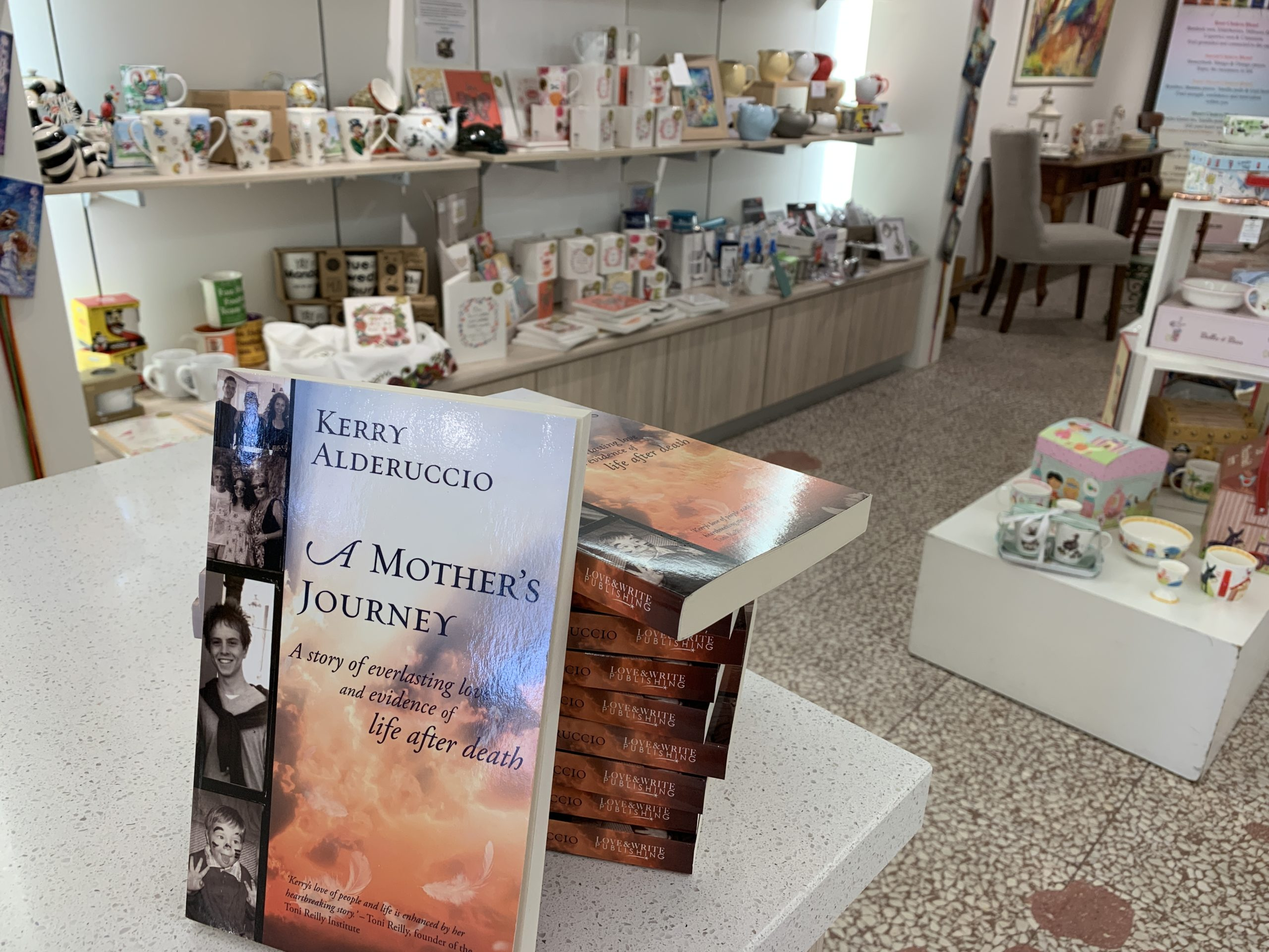 A Mother's Journey by Kerry Aldericcio stacked up at Tea Empress